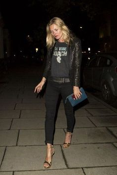 kate moss black pants graphic tee sequin jacket gold sandals clutch