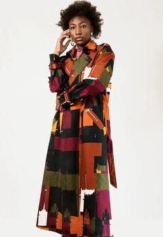 Made with the Gidan Sarki fabric from the #ZURIandIMANI #OutOfAfrica fabric collection. Double-breasted dropped shoulders trench coat with epaulettes, detachable belt, kent collar, 8-button fastening, a back vent , two welt side pockets and long sleeves with buttoned sleeve strap.   #womensouterwear #womenscoat #womensfashion #streetstyle #fashionweek #customfabric #surfacepatterndesign #africanprint #patterndesign