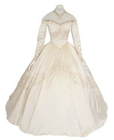 Elizabeth Taylor's very first wedding dress (8 more followed) will go up for auction at Christie's on 6/26/13 in London.  The Helen Rose-designed gown is expected to fetch around $75,000. The dress, completely custom-made for her, was a gift from MGM studios. Made of 25 yards of shell satin embellished w/ bugle beads & seed pearls;  a 15-ft long satin train & a built-in corset. (It has a 22-in waist that's been 'let out'; Taylor's was 20-in when she wed Conrad Hilton, Jr., in 1950, at age…