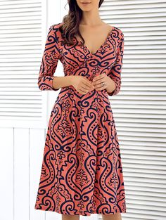 Plunging Neck Printed Dress                                                                                                                                                                                 More