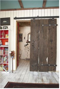 Rustic sliding barn door-like the idea if using metal strips to attach boards together...I probably wouldn't go quite that rustic w/ the wood though.