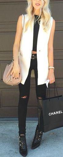 white sleeveless blazer, so rock chic but elegant #love