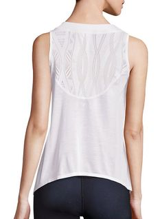 "crest lace inset tank top by Alo Yoga. Mesh lace insets style lightweight tank top. Ribbed crewneck. Sleeveless. Curved hem. Pullover style. About 25"" from ..."
