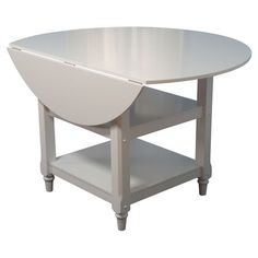 Drop-leaf dining table with a bottom storage shelf.Product: Dining tableConstruction Material: MDF and solid wood...