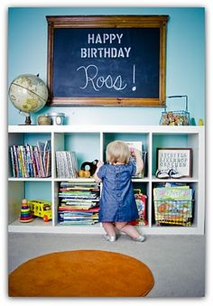 Love the chalk board, the bookshelf, and the old metal bins the books are stored in!