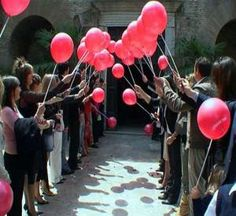 After bride and groom marry, have the guests form tunnel with balloons. As bride/groom walk past guests, they let go of their balloon. to Send well wishes of love/happiness for the couple into the sky