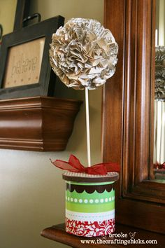 Christmas topiary from old book pages and cake frosting container...love it!