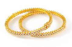 http://www.meenajewelers.com/images/64_Stone_bangles_4461.jpg