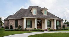 4 Bed Acadian House Plan with Bonus Room - 56399SM | Acadian, European, French Country, Photo Gallery, 1st Floor Master Suite, Bonus Room, Butler Walk-in Pantry, Jack & Jill Bath, PDF, Corner Lot | Architectural Designs
