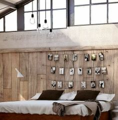 So many things to love about this- the hanging photos, wood wall, lighting, etc!