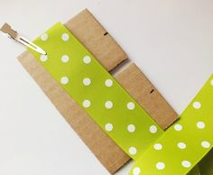 How to Make Bows: Pinwheel Bow {The Ribbon Retreat Blog}: Great explanations, including making a cardboard template, and stitching the crease into the bows and spikes.