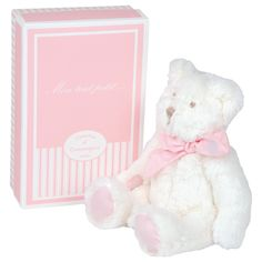 This adorable teddy bear will be a much loved addition to any child's soft animals collection.  Designed in France.