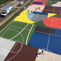 White lines were painted over the top of the coloured background, which includes hues of blue, green, red, yellow, brown and grey. Basketball Park, Outdoor Basketball Court, Basketball Birthday, Basketball Quotes, Girls Basketball, Louisville Basketball, Basketball Scoreboard, Urban Landscape, Landscape Design