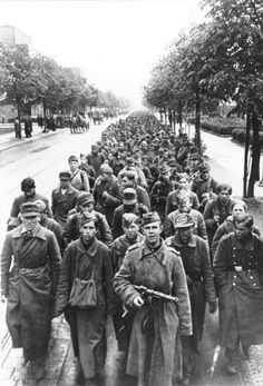 A Soviet soldier leads a column of German prisoners of war, most of whom are teenagers. Berlin, Germany. May 1945. If captured by the Western Allies, such boy soldiers were turned loose after registration. If they were caught by the Russians, their future was a lot more ominous.