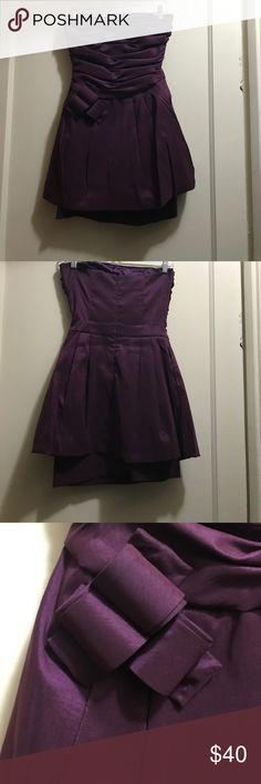 Purple Jessica McClintock Dress Only worn once! This deep purple dress has a layered, figure-flattering skirt, a rouched, strapless top, and a cute abstract bow detail at the waist. Formal, semi-formal, cocktail, homecoming, prom Jessica McClintock Dresses Strapless