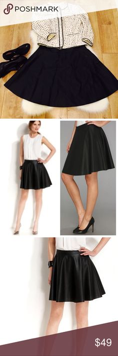 Vince Camuto•Perforated Vegan Leather Skirt•8 Vince Camuto Perforated Black Faux Leather A Line Skirt. This fully lined flouncy skirt is perfect for fall and winter. No stains, tears or visible wear. Size 8. Vince Camuto Skirts A-Line or Full