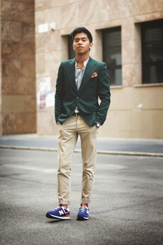 Green jacket, slim chinos and blue sneaks