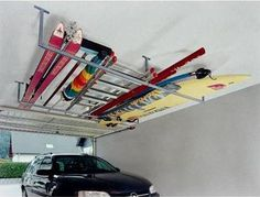 I helped a friend of mine finish his basement but he was not sure what type of ceiling he wanted to put in. Garage Storage Solutions, Storage Hacks, Garage Organization, Garage Shop, Garage House, Surfboard Rack, Roof Box, Ceiling Storage, Basement Stairs