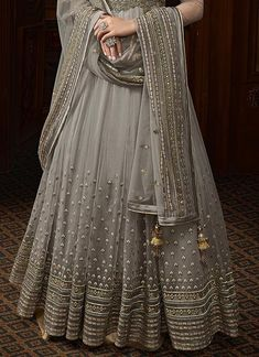Silver Grey Embroidered Net Anarkali Suit is designed with absolute perfection to rock any festive occasion or wedding parties. This set features intricately embossed embroidery work with zari, thr. Lehenga Designs, Kurta Designs, Kurti Designs Party Wear, Bridal Anarkali Suits, Party Wear Lehenga, Party Wear Dresses, Bridal Lehenga, Indian Gowns Dresses, Pakistani Dresses