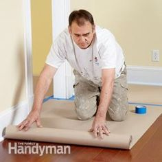Drop cloths can be a hassle. They slip on hard floors, get bunched up under ladders and are difficult to fit tight to baseboards. Eliminate the hassle and save time by using rosin paper instead. For about $12, you can buy a 160-ft.-long roll of 3-ft.-wide heavy masking paper. Roll it out, leaving about a 1/2-in. space along the wall for the tape. Then cover the edges with tape to keep it in place. You'll find rolls of masking or rosin paper at home centers and paint stores.