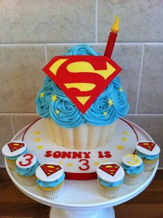 Superman Giant Cupcake with matching mini cupcakes and a handmade fondant candle and sign