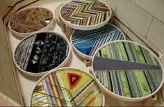 A fused glass melt and several strip plates ready to be fired