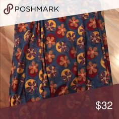 LulaRoe Large Azure Azures are knee-length skirts with gold over waistband and can easily be worn at different lengths. Worn once and washed according to Lula directions. LuLaRoe Skirts Midi
