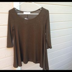 Olive Green Top Super pretty and flowy. 3/4 sleeve and longish. Would def look great with some leggings. It's in mint condition except for two black dots in back. They look like they're part of the shirt so it's not so bad. Please feel free to make an offer via offer button. •No Trades• Urban Outfitters Tops