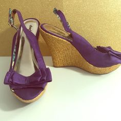 Purple flower lines bow wedges. Worn a handful of times. Still looks like new. Charlotte Russe Shoes Wedges