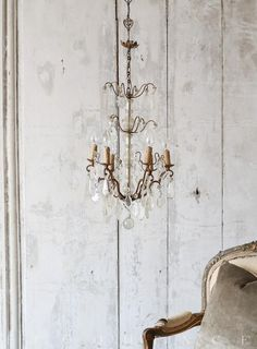 Eloquence, Inc. Antique French Chandelier: 1900 Darling antique chandelier in warm oxidized bronze tone with a delicate glass bobeche stem. Six scrolling arms are adorned with dangling scalloped and cut glass crystals. Charming piece perfect for a smaller bedroom or hallway. 24H x 16W x 16D  Circa: 1900. <3 <3 <3