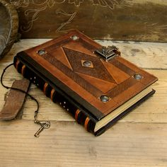 "Leather Journal / Blank Book with Lock and Key, Brown Antiqued Leather - ""The Brown Book"". $190,00, via Etsy."
