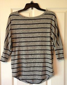 I own a shirt almost like this that I wear with coral cord jeans and leopard ballet flats from Sam Edelman. It was done by a Nordstrom stylist and I love it. I wouldn't have put it together myself.