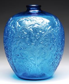 "Early Lalique, distinguished by the signature ""R. Lalique"", included an outstanding acanthus vase with branch and leaf decoration"