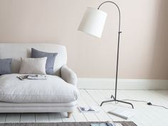 A sophisticated, curved floor lamp that's great for tight spaces? That's a slam dunk in our book.