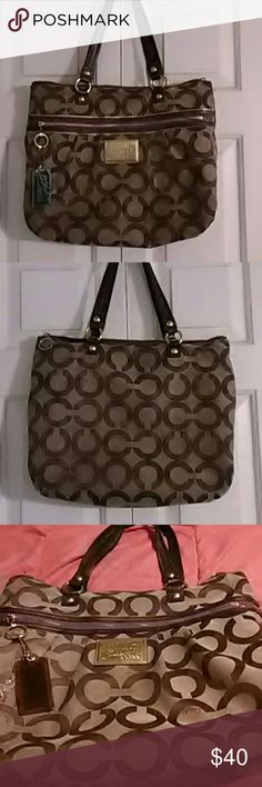 Coach Poppy Bag Large, Brown with purple on front zipper area. The only thing this bag needs is cleaning on area spots on the outside and some around the opening on inside. No tears or rips. Very good used condition. Coach Bags Shoulder Bags