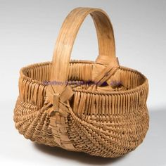 """Price Realized: 431.25   APPALACHIAN RIB-TYPE WOVEN SPLINT DIMINUTIVE EGG BASKET, white oak, finely woven kidney form with double rim and arched handle. Original dry natural surface. First half 20th century. 5 3/4"""" HOA, 3 1/4"""" H rim, 5 1/4"""" D rim.  Excellent condition with no breaks or losses."""