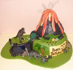 Dinosaur birthday cake with volcano and river by JMC Custom Cakes, via Flickr
