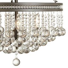 The Regina chandelier sparkles with refined style and clear crystal baubles. wide x high. Round canopy is 5 wide. Style # at Lamps Plus. Sloped Ceiling, Ceiling Lights, Dramatic Lighting, Light Side, Bronze Finish, Clear Crystal, Farmhouse Style, Vintage Inspired, Chandelier