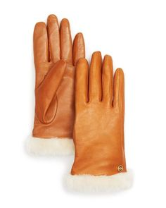 Ugg classic leather tech gloves: http://www.stylemepretty.com/living/2016/01/29/cute-cold-weather-accessories/: