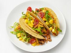 Diced mango gives a sweet touch to these Turkey Sausage Tacos that get a kick from ancho chile powder.