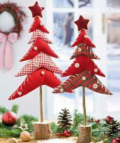 Fabric Christmas Trees on dowels with a wooden base.