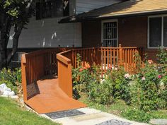 """A beautiful, simple home ramp that fits with cottage/ranch look, doesn't scream """"accessible"""" and also handy for stollers, carts and other uses- in cold weather areas put an extended roof by the door over the decking."""