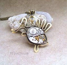 pendant of brass wire made by hand the central element - the clockwork