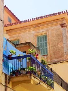 overhanging wooden balcony in the old town Nafplio Greece Crayola Box, Window Boxes, Balconies, Old Town, Places To See, Greece, Beautiful Places, Old Things, Around The Worlds