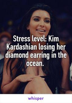 Stress level: Kim Kardashian losing her diamond earring in the ocean.