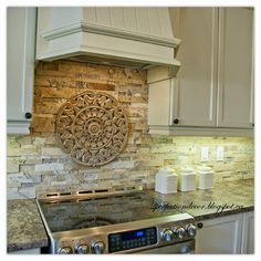 Medallions for backsplash our floral tile and thin liners in antique brown along with flat for Michigan design center home tour