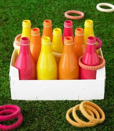 Pour 1 Tbsp acrylic paint into a clean 12-oz glass soda bottle. Roll bottle to distribute paint; invert it to allow excess to drip out. Set bottle upright and let dry. Set up bottles and play!