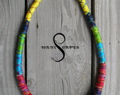 Gorgeous and original OOAK tribal yarn-wrapped necklace set inspired by Maasai tribal jewelry. This time its done in interesting palette of vibrant pastel colors. Yarn-wrapped with luscious silk yarns. Multi-strand necklace is wrapped with 100% silk thread and has convenient crochetted closure as in other masajka-type necklaces. Rope necklace is partially wrapped with silk and viscose threads and has a metal closure. Additionally adorned with a hand-made button (not detachable) created by…