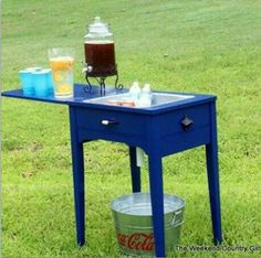 Repurposed sewing machine table used for a drink cooler