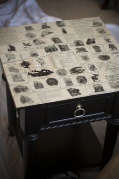 Decoupaged end table made with images from Harry Potter books.